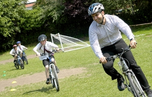 Cllr Bassam Mahfouz joins cycle-trained pupils at St. Gregory's school during Bike Week