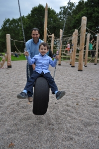 Cllr Mahfouz with his son Alexander enjoying the opening day of the Walpole Park play area