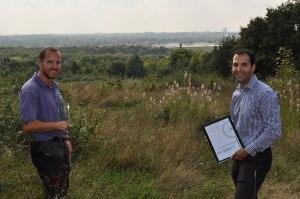 Park Ranger Tim Crane with Cllr Bassam Mahfouz at the Gold winning meadow on Horsenden Hill