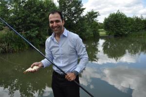 Cllr Bassam Mahfouz does a spot of fishing at the award winning Northala Fields