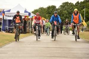 Cllrs Julian Bell and Bassam Mahfouz leading cyclists at Northala Fields for this year's Ticket to Ride